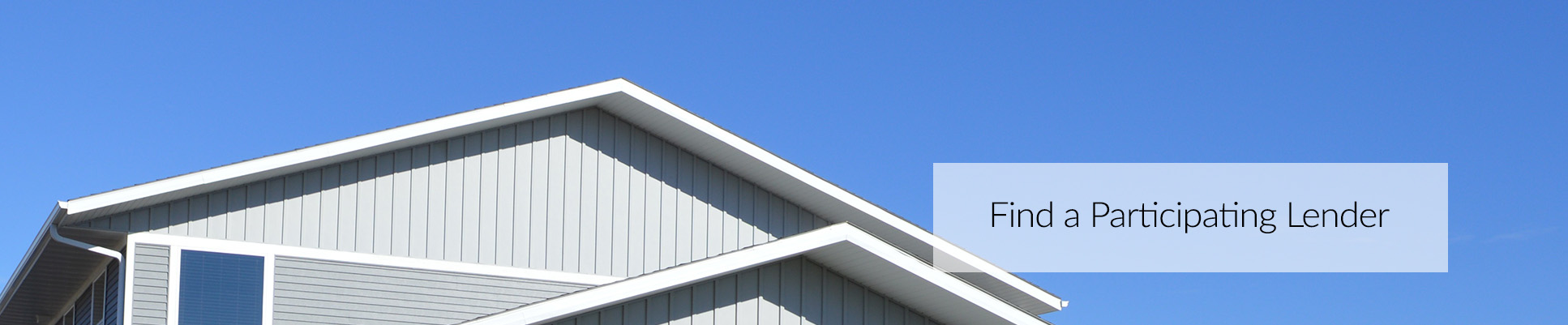 peaks of a gray house with blue sky